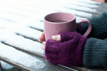 Cup of cocoa outdoors in winter
