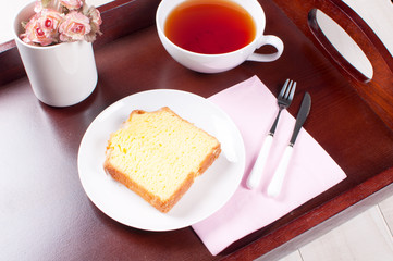 Tray with breakfast tea and lemon loaf