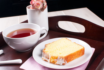Lemon pound cake with tea on a tray