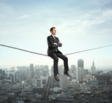 man sitting on rope