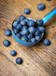 a ladle with blueberries
