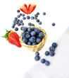 blueberries in a little basket on a white background