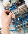 Leinwandbild Motiv Hand of an electrician