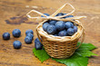 blueberries in a little basket on an old table