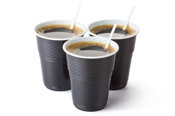 Three vending coffee cups