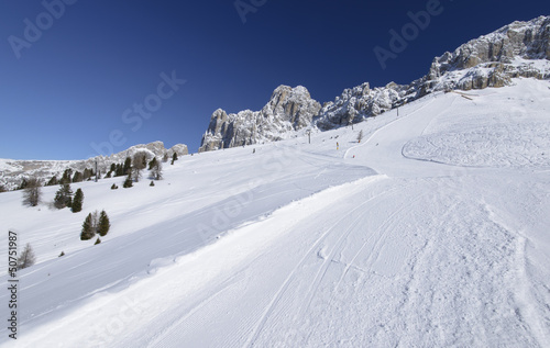 bright snow on Laurin ski run and Rosengarten, Costalunga pass