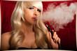 Woman smokes a hookah