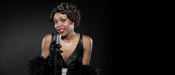 Vintage jazz woman singing. Black african american. Copy space.