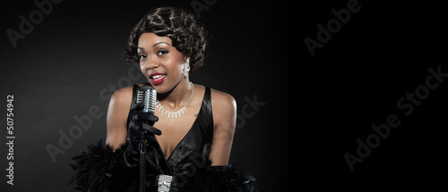 Vintage jazz woman singing. Black african american. Copy space.