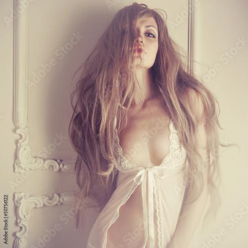 Leinwanddruck Bild Sensual lady in classical interior