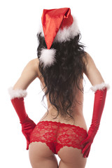 Topless santa helper. Woman with red bikini, hat and gloves