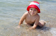 Cute little boy enjoying the sea