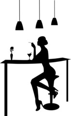 Girl drinking martini and smoking a cigarette in a bar