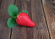 Strawberry with leaf on wood II