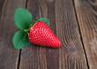 Strawberry with leaf on wood II