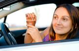 Woman enjoying coffee in her car