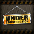 Under construction sign yellow on black background, vector