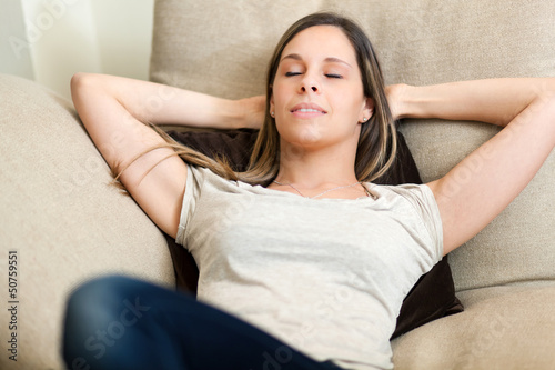 Woman relax at home on sofa