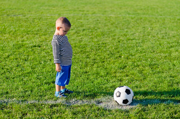 Little boy about to kick a soccer ball
