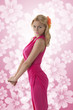 pretty blonde girl with pink dress in profile