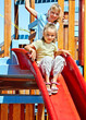 Children move out to slide in playground