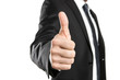 Young businessman showing thumbs up isolated on white