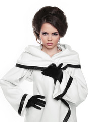 Fashion model girl with hairstyle in white coat isolated on whit