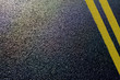 asphalt detail with yellow double line