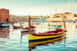 Fort St Angelo Seafront and maltese boat LUZZU