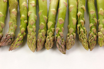 Fresh asparagus isolated on white.