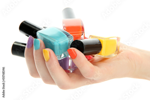 woman hand with nail polishes isolated on white