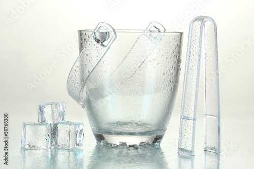 Glass ice bucket isolated on white