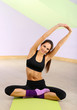Young women in yoga style, at gym