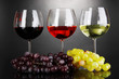 Assortment of wine in glasses on grey background