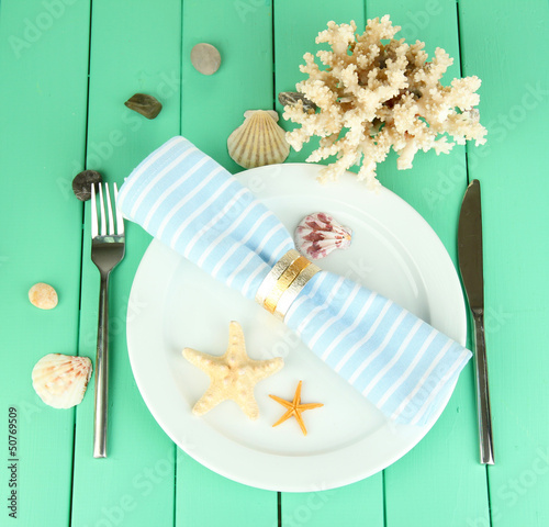 Marine table setting on color wooden background