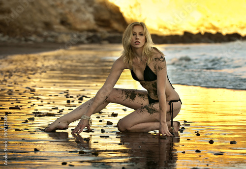 Foto op Aluminium Strand Sexy model posing at golden sunset at passific coast