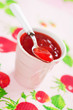 Strawberry jam in ceramic cup, selective focus