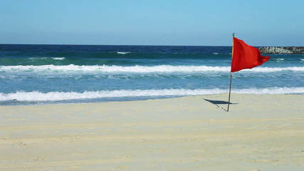 Red danger flag at the beach