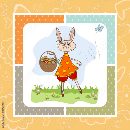 Easter bunny with a basket of Easter eggs