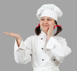 Woman chef in uniform isolated on a gray background.