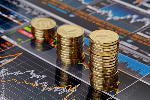 Uptrend stacks coins,on the financial stock charts as backgrou
