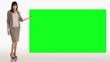 Businesswoman presenting a green screen