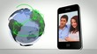Video of couples presented on smartphone beside globe