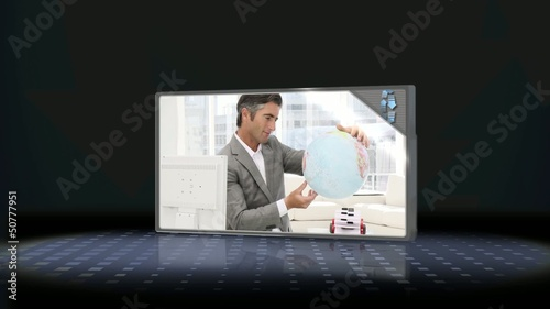 Businessman looking at globe and couple packing suitcase
