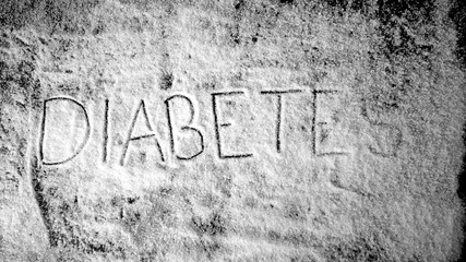 Diabetes written into sugar powder being blown away