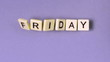 Plastic letters bouncing and spelling out Friday