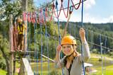Woman climbing on rope ladder adrenalin park poster
