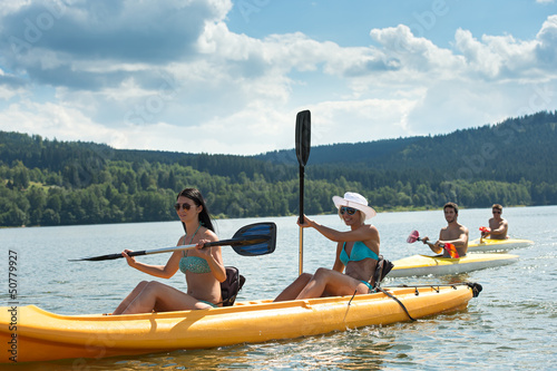 Young students kayaking in the sunshine