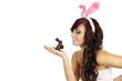 Woman holds a chocolate bunny