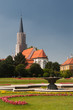Fountain in Schonbrunn park with church at background